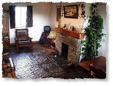Openhaard in  Stone Cottage  - klik op de foto voor een vergroting